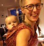 Woman carrying child in baby wrap
